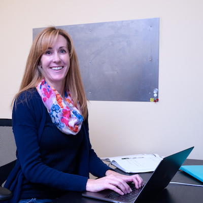 dani sits at desk working on marketing and business messaging solutions for customer service