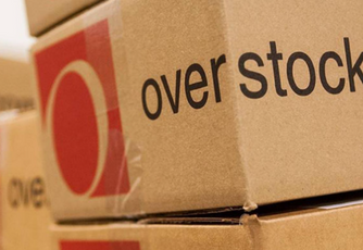 Stack of cardboard boxes with red Overstock logo