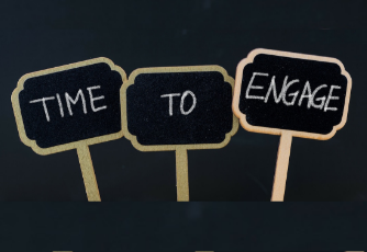 "3 signs that say ""Time to Engage"" written in chalk"