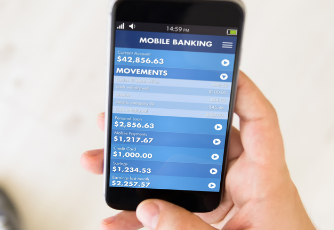 Person holding a smartphone while using a mobile banking app
