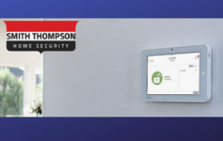 Smith Thompson Home Security logo beside a modern touchscreen security system