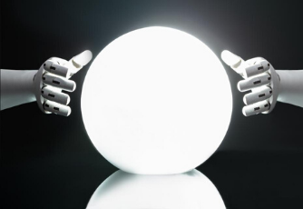 Two robotic hands surround a glowing white sphere