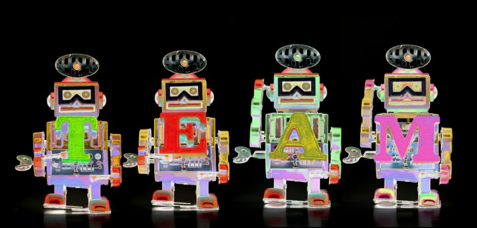 Robots spelling out the word TEAM